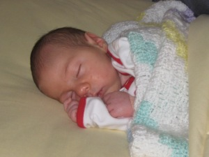 Julian loved his co-sleeper but not as much as he loved sleeping with his mommy and daddy