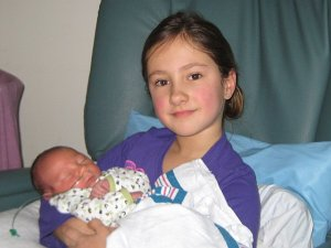 The proud Lilliana, holding her beautiful, sweet baby brother, Julian